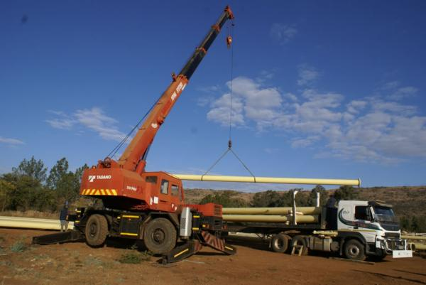 Crane Truck Loading HDPE Pipe